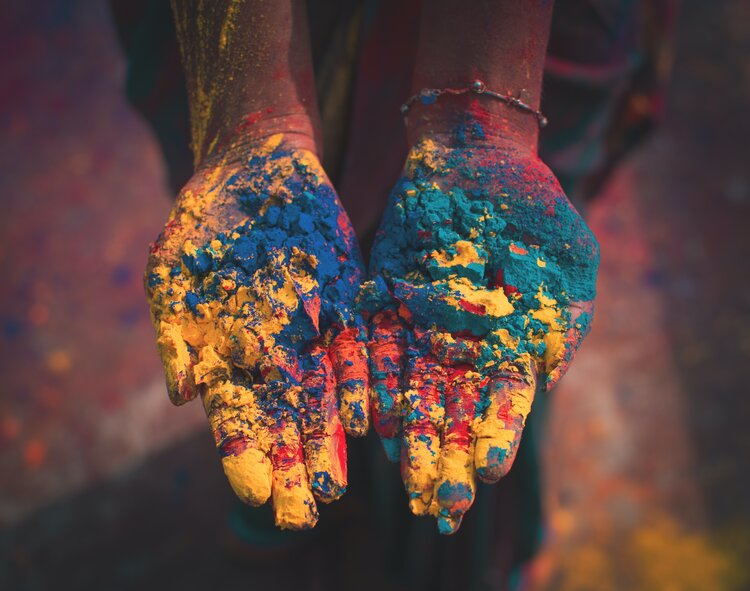 hands covered in colour